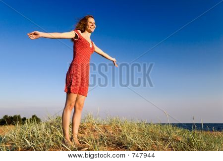 Girl standing on a dune