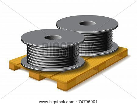 Coils With A Black Cord Are On A Wooden Pallet.
