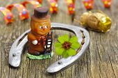 picture of talisman  - horseshoe, clover leaf and sweet talisman for new years