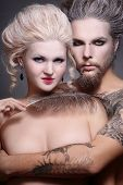 picture of marquise  - Portrait of pierced tattooed man and woman with old - JPG