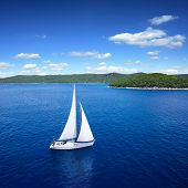 stock photo of windy  - Yacht sailing on open sea at windy day - JPG