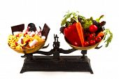 stock photo of junk food  - The choice between healthy and unhealthy food on scales - JPG