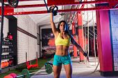 stock photo of kettlebell  - brunette girl at gym lifting a kettlebell weightlifting workout - JPG