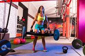 pic of gym workout  - Hex Dead Lift Shrug Bar Deadlifts woman at gym workout weightlifting - JPG