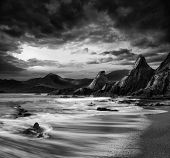 stock photo of long distance  - Stunning mountain and sea sunset landscape black and white - JPG