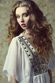 pic of vintage jewelry  - Sensual curly woman wearing vintage dress posing like a antique dame with jewelry and dramatic make - JPG