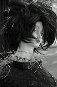 image of scarecrow  - A mannequin scarecrow sporting Gothic attire and black wig - JPG