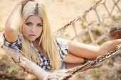 image of shepherdess  - Sexy fashion woman in cow girl country style on hay stack - JPG