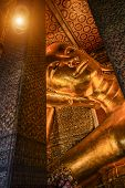 picture of recliner  - Reclining Buddha gold statue face - JPG