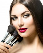 picture of makeover  - Beauty Woman with Makeup Brushes - JPG