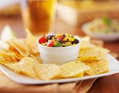 foto of poblano  - mexican fire roasted corn and black bean salsa with tortilla chips and beer - JPG
