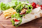 stock photo of sandwich wrap  - Chicken fajita wrap sandwich - JPG