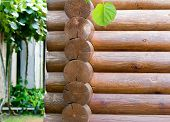 stock photo of log fence  - Part of wall of house from wooden round logs - JPG