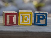 picture of dyslexia  - Alphabet blocks arranged to spell IEP - Individualized Education Plan. Used for special education services in elementary, middle and high schools. ** Note: Visible grain at 100%, best at smaller sizes - JPG