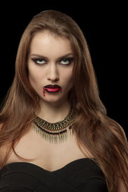 foto of pale skin  - Portrait of a pale gothic vampire woman on a black background - JPG