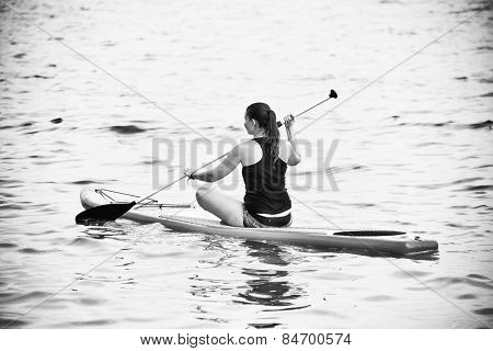 Young woman paddleboarding on a lake