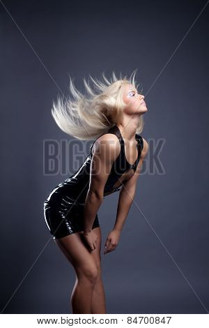 Alluring go-go dancer with flying hair