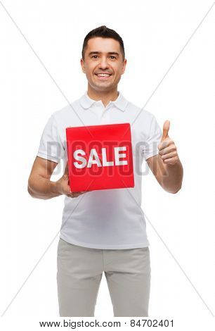shopping, discount, consumerism, gesture and people concept - smiling man with red sale sigh showing thumbs up