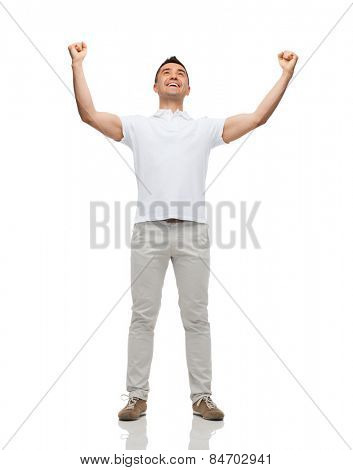 happiness, gesture and people concept - happy man with raised hands