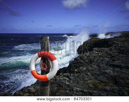 Life Swimming Belt On The Rocky Coast
