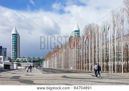 Lisbon, Portugal - February 01, 2015: Flags of all countries of the world in Rossio dos Olivais (Olive Grove Square). Parque das Nacoes (Park of Nations). Sao Gabriel Tower and Vasco da Gama Mall