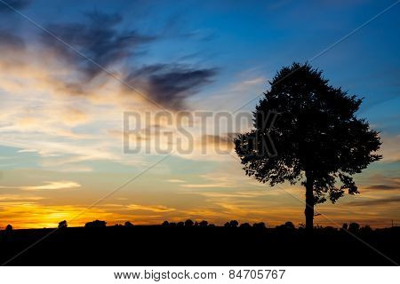 Sunset Over Rural Field