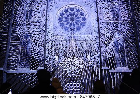 PRAGUE, CZECH REPUBLIC - OCTOBER 17, 2013: People watch a projection mapping by Czech art group The Macula on the facade of St Ludmila Church during the Signal Festival in Prague, Czech Republic.