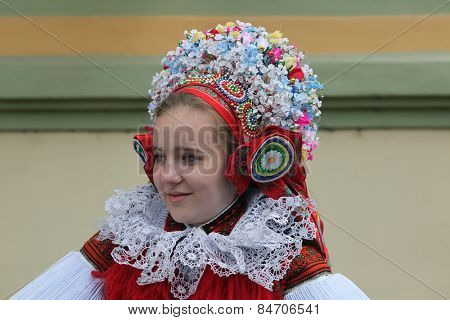 VLCNOV, CZECH REPUBLIC - MAY 26, 2013: Young woman dressed in traditional Moravian folk costumes attends the Ride of the Kings folklore festival in Vlcnov, South Moravia, Czech Republic.