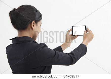 Side view business woman self portrait with smart phone