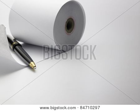 pen and roll of paper