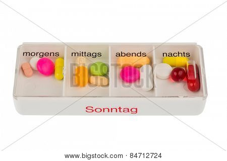 tablet dispenser symbolic photo for therapy, prescription and dosage