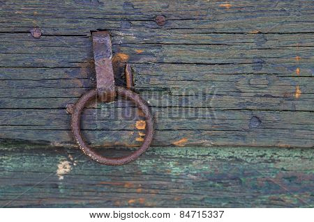 Rusty ring pull on shed door.