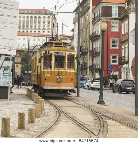 PORTO, PORTUGAL - FEB 18, 2015: Heritage tram tourist line on the shores of the Douro. Construction its tram network started in Sep 12 1895, therefore being the first in the Iberian Peninsula.
