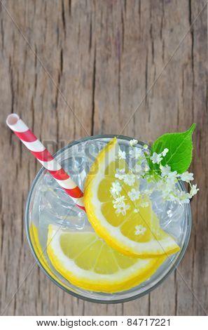 elderflower juice with lemon on old table