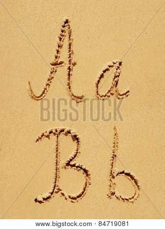 Concept or conceptual sand font or letter set group or collection carved on exotic beach near sea isolated on a sandy background, metaphor to nature, natural, education, character, message or summer