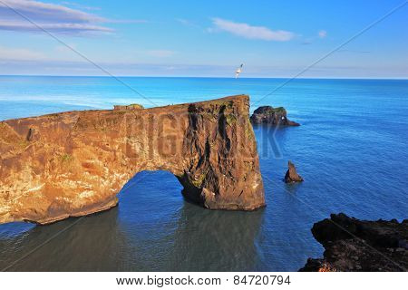 Cape Dyrholaey in southern Iceland. Sunset in July. The colossal rock in the sea in the form of an elephant
