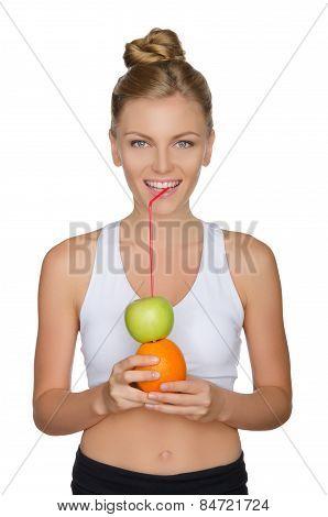 Attractive Woman Drinking Juice From Apple, Orange