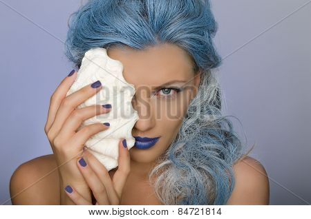 Charming Woman With Blue Hair And Shell Of Person