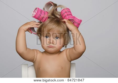 Little Attractive Kid With Hair Curlers