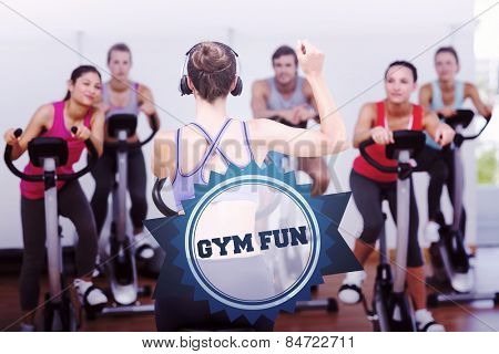 The word gym fun and trainer and fitness class at spinning class against badge
