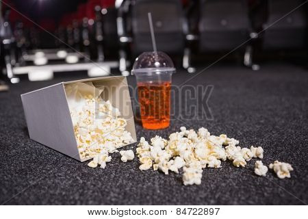 Falling box of pop corn and drink at the cinema