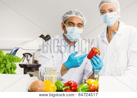 aFood scientists looking at a pepper t the university