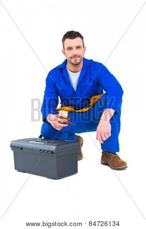 Electrician smiling at camera on white background