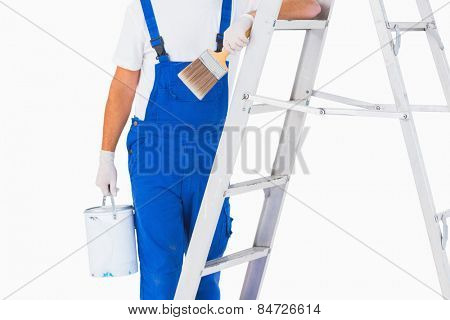 Midsection of handyman with paintbrush and can on ladder over white background