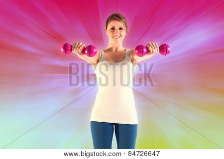 Woman holding weights against abstract background