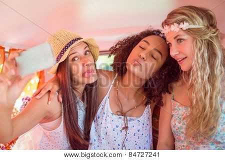 Hipster friends on road trip taking selfie on a summers day