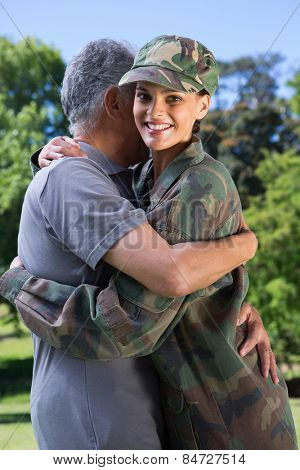Soldier reunited with her father on a sunny day