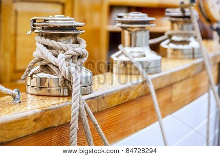 Closeup of winches with lines on a large sailing boat