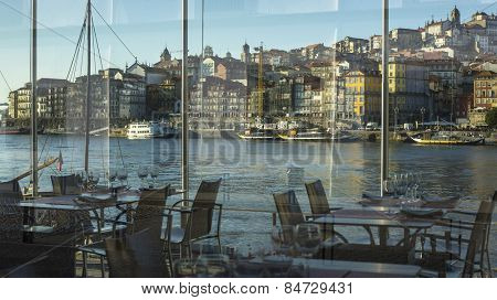 View of embankment Ribeira in old town of Porto from the restaurant window, Portugal.