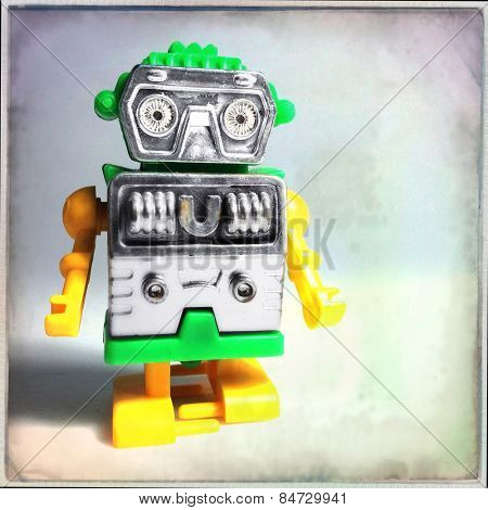 Instagram filtered image of a vintage toy plastic robot